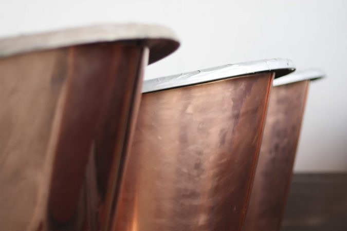 Our cast iron baths can be clad in either brass or copper, combining durability with elegance.